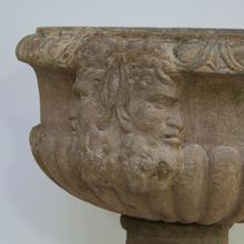 Beautiful sandstone planter with double faun head, France circa 1750