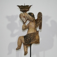 Stunning period piece. Baroque angel with its original color holding a torchere. Very beautiful piece