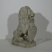 Unique 18th century hand carved marble lion with a stunning weathered look.
