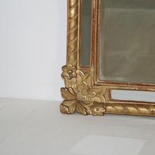 Small Louis XV Baroque Giltwood Mirror, France 18th century.